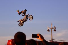 Free A Man On Bike Jumps Over The City. Stock Photography - 146233402