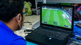 Free A Man Playing Fifa 19 On Gaming Laptop Using A Console Stock Photos - 160287763