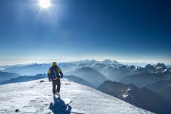 Free A Man Stands On Top Of Mount Elbrus Royalty Free Stock Photo - 117791405