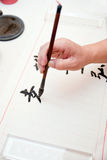 A Man Was Writing Chinese Calligraphy Royalty Free Stock Photos