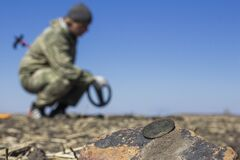 Free A Man With A Metal Detector In The Vast Expanses Of An Old Defensive Fortress In Search Of Ancient Coins And Artifacts, The Stock Image - 214075571