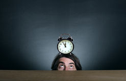 A Man With An Alarm Clock Stock Photography