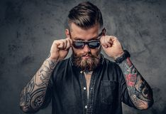 Free A Man With Tatoos On His Arms. Royalty Free Stock Image - 110960696