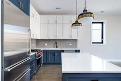 Free A Modern Kitchen With Blue And White Cabinets. Stock Images - 191925094