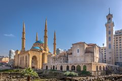 Free A Mosque And A Church Together In Beirut, Capital Of Lebanon In A Blue Sky Day Royalty Free Stock Images - 127702259