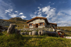 A Mountain Chalet With Fountain In Front, In The Vanoise Nationa Royalty Free Stock Photo