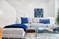 Free A Neutral Colored Living Room With Blue Accents. Royalty Free Stock Photography - 195628197