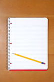 A Note Book And Pencil On A Desk Stock Photography