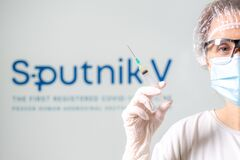 Free A Nurse With A Syringe Of Russian Sputnik V Vaccine Stock Photo - 211289120