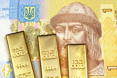 Free A One Hryvnia Note From Ukraine With Three Gold Ingots Royalty Free Stock Image - 143302666