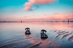 Free A Pair Of Slippers Left At The Shore Of Boracay For An Early Morning Walk Royalty Free Stock Images - 174114269