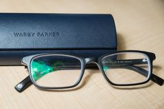 Free A Pair Of Warby Parker Glasses Stock Image - 138693161