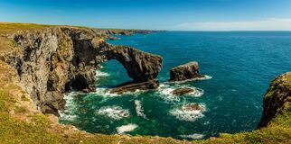 Free A Panoramic View Of The Green Bridge Of Wales Standing Proud In The Early Summer Sunshine On The Pembrokeshire Coast, Wales Royalty Free Stock Image - 194752556