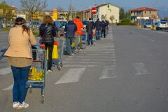 Free A Parking Lot Of A Grocery Store, Many Customers In A Long Line Because Of Social Distancing Rules During Pandemic.Young Woman Up Royalty Free Stock Images - 179562759