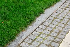 Free A Pedestrian Pavement Made Of Stone Cobble And Granite Tiles. Stock Photos - 170615023