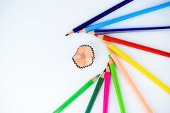 Free A Pencil Shaving Surrounded By Different Colored Wooden Pencils ,making A Beautiful Pattern Royalty Free Stock Images - 172692379