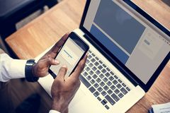 Free A Person Using A Mobile Phone And Laptop Stock Image - 114745171