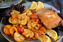 Free A Piece Of Baked Trout With Mushrooms And Vegetables On A Plate With Lemon Slices. Stock Images - 160499074