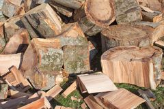 A Pile Of Freshly Chopped Wooden Logs. Pile Firewood Prepared For Fireplace Stock Photos
