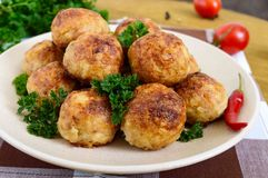 A Pile Of Golden Meat Balls On A Plate Stock Photos