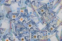 Free A Pile Of One Thousand Philippines Peso Banknotes. Cash Of Thousand Dollar Bills, Peso Background Image Royalty Free Stock Photo - 218818545