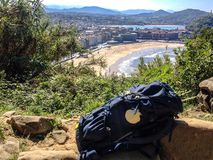 Free A Pilgrim`s Backpack On A Hill With An Amazing View Over San Sebastian, Camino Del Norte Route, Northern Saint James Way Royalty Free Stock Image - 138987986