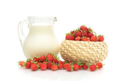 A Pitcher Of Milk And Wild Strawberries Stock Photo