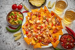 Free A Plate Of Delicious Tortilla Nachos With Melted Cheese Sauce, Grilled Chicken Stock Photo - 148875100