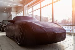 Free A Prepared Gift At A Car Dealership, A Sports Car Closed With A Blue Case Made Of Special Fabric, Sewn In An Individual Workshop Royalty Free Stock Photography - 134028887