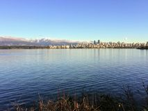 Free A Pretty View Looking Across The Calm Waters Of English Bay At The Beautiful Skyline Of Downtown Vancouver, Royalty Free Stock Image - 133747486