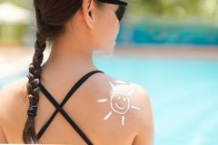Free A Pretty Woman Putting On Sunblock At The Pool. Skincare Stock Images - 168023214