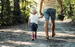 Free A Rear View Of Father With A Small Toddler Son Going Fishing. Royalty Free Stock Photos - 143599908