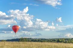 Free A Red Aircraft Balloon Is Flying Far Away On The Horizon Stock Photography - 190531402