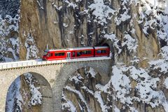 Free A Red Train Is Coming Out Of The Tunnel Of The Famous Landwasser Viaduct, Switzerland Stock Photography - 137611852