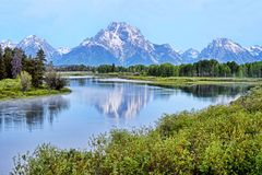 Free A River In Colorado Reflects Snow Capped Mountains. Royalty Free Stock Image - 105403266
