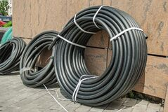 Free A Rolled Up Black Industrial Rubber Hose Tied With Rope On The Street Stock Photography - 188215822