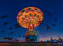 Free A Rotation Chain Carousel Illuminated With Different Bright Colors. Royalty Free Stock Photography - 157269187