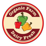 A Round Dairy Fresh And Organic Farm Logo With Bell Peppers Stock Image