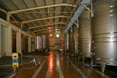A Row Of Fermenters Inside A Modern Winery Stock Images