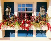 Free A Row Of Potted Artificial Flowers Hung On The Window Stock Photos - 139868953