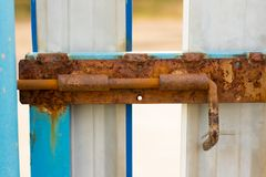 Free A Rusty Old Bolt On The Metal Doors Royalty Free Stock Images - 160370489