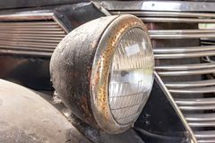 Free A Rusty Old Car Front Headlight Close Up Stock Image - 165380831
