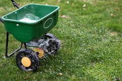 Free A  Seed  And  Fertilizer Spreader Out On A Lawn Royalty Free Stock Photos - 175401938