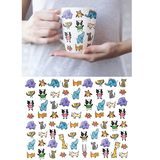 A Set Of Animals On The Ceramic Tea Cup Isolated On White Royalty Free Stock Images
