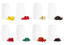 A Set Of Capsules Next To A White Plastic Medicine Bottle. Stock Photography