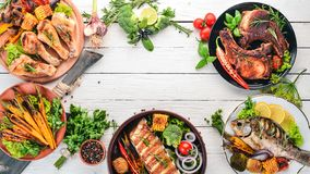 Free A Set Of Food. Steak, Fish, Vegetables And Spices. On A Wooden Background. Royalty Free Stock Image - 151216756