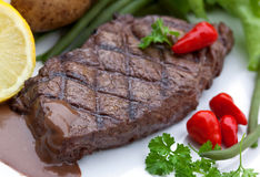 A Sirloin Strip Steak With Vegetables And Savory Stock Photography