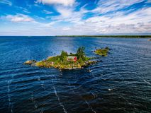 Free A Small Red Cottage On An Island In The Blue Sea On A Summer Day. Finland. View From Above. Stock Images - 110284474