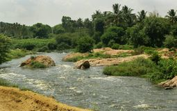 A Small River With Hills Natural Landscape. Royalty Free Stock Photos