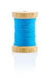 A Small Wooden Bobbin With Blue Thread Stock Photography